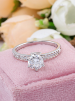A simple and dainty round solitaire festuring six prongs (7)