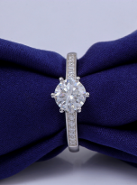 A simple and dainty round solitaire festuring six prongs (9)