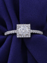 Halo engagement ring boasts a petite band (5)